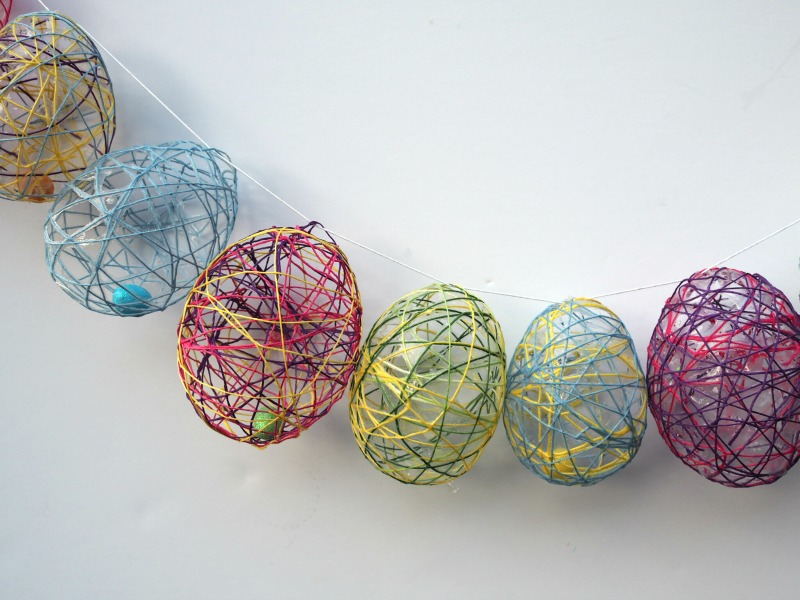 I have seen string eggs made before and we decided to give it a go. It was tricky, sticky but lots of fun! Read on to find out how to make a Beautiful Easter Wreath made from colourful string eggs. You can even hide a surprise inside the eggs!