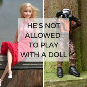 boy play with doll