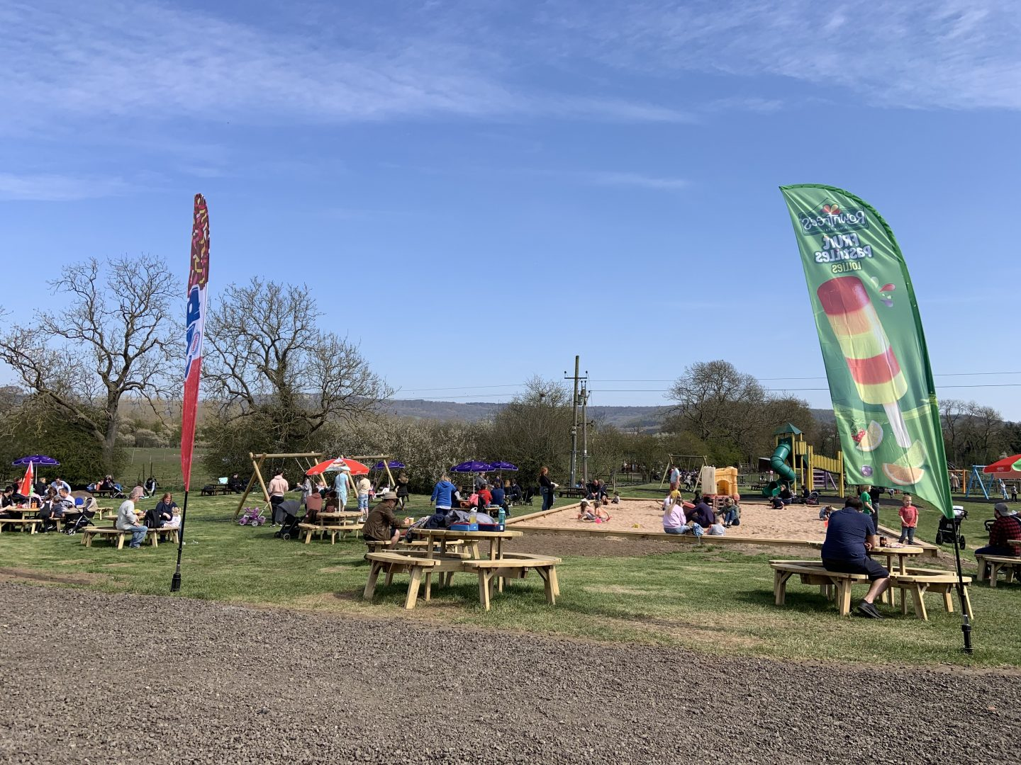 A view of the sandpit and picnic tables at Monk Park Farm